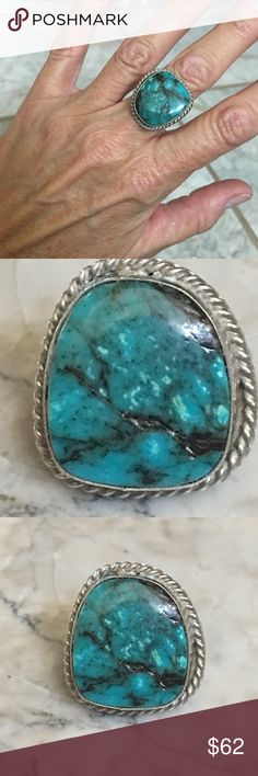 Native American Sterling Large Turquoise Ring Native American Sterling Silver tested Large size Turquoise Stone Ring. This has a beautiful piece of turquoise in it and its a decent sized one too. Has natural matrix lines wry beautiful. Size is shown in pictures and is approximately 7.5 Please view all pictures for size and ask any additional measurements before you purchase. I believe this is Navajo made Jewelry Rings
