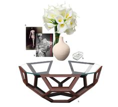 Create an unconventionalmodern setting with this abstract teak wood coffee table. We suggest this look for a room which mostly features shades of white. The classic trifecta of books, a ceramic vase and a chic jewellery box will make your table into an instantfashion statement. Calla lilies are a gorgeously sophisticated way to incorporate fresh flowers into your coffee table decor. To shop these products, read our blog!
