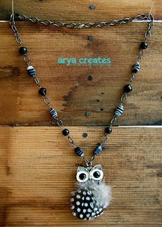 Hey, I found this really awesome Etsy listing at https://www.etsy.com/listing/191671458/feathered-owl-necklace