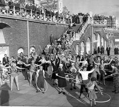 Hula-hooping, Brighton 1958 Art Print by Mirrorpix at King & McGaw Brighton Museum, Brighton Rock, Brighton England, Brighton And Hove, Brighton Sea, Seaside Shops, Images Of England, Framing Canvas Art, British Seaside