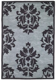 Covered with truly elegant emblems, this lovely area rug is sure to add more than a touch of class to any room in your home. Let the deep blue coloring of this rug create a unique color scheme that is both relaxing and attractive. Home Goods Store, Online Home Decor Stores, Traditional Area Rugs, Traditional House, Stenciled Floor, Floor Stencil, Purple Grey, Unique Colors, Blue Area Rugs