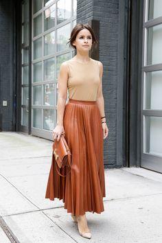 Miroslava Duma teamed  sleeveless tan tee w/ pleated maxi skirt & Hermés H  bag #StreetStyle