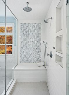 Beautiful blue and white bathroom features a seamless glass shower fitted with a polished nickel rain shower head mounted to white staggered wall tiles above gray grid floor tiles. White Bathroom, Bathroom Wall, Bathroom Interior, Modern Bathroom, Small Bathroom, Rain Shower Bathroom, Bathroom Shelves, Master Bathroom, Bad Inspiration