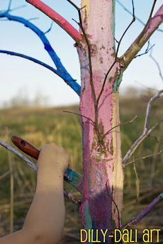 Paint a rainbow tree- a great project for Winter.  Brings color to the bleak trees. I love this!