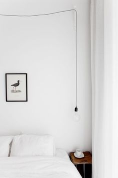 Minimalist bedroom. Photo by Jakob Nylund.