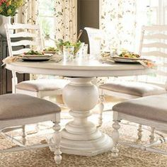 """Weathered pedestal dining table with a hexagon-shaped base.    Product: Dining tableConstruction Material: WoodColor: LinenFeatures: Part of the Paula Deen Home Collection Hexagon-shaped baseIncludes one 18"""" leaf  Dimensions: Without Leaf: 30"""" H x 54"""" DiameterWith Leaf: 30"""" H x 72"""" W x 54"""" D Note: Chairs not included"""