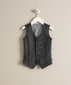 """Boys herringbone vest. Amazing way to incorporate darker colors without the """"dark blob"""" effect in photos. Plus it's a great layering piece with some perfect texture."""