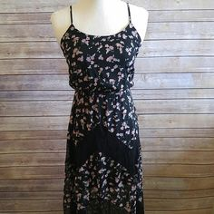 "Floral and lace maxi dress So pretty and in amazing condition...except it missing its belt. Still looks amazing without it or you can add your own for a unique touch. Open to offers!!!  Lined to the lower thigh. Sheer bottom. Ties in back.   Polyester. Lace is nylon.  55"" length. Candie's Dresses Maxi"