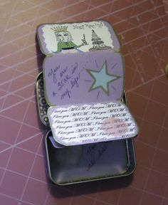 mini book foldout from altoid tin!