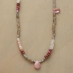"""INTERJECTIONS NECKLACE--Pink gems of topaz, quartz and sapphire, along with moonstones and sterling silver beads interpose labradorites. A rhodochrosite briolette marks the midpoint. A handcrafted exclusive with sterling silver lobster clasp. 19""""L."""