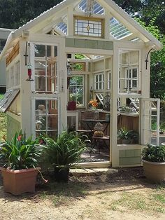 This greenhouse was constructed by David Mayrand with reused/recycled materials purchased at yard sales, Goodwill and the Habitat ReStore. Most all of the items inside the greenhouse were purchased from the same places as well. It has become the neighborhood attraction and they have had many strangers stop in for pictures and a tour. It is a happy place for sure! This greenhouse wins BEST IN SHOW!