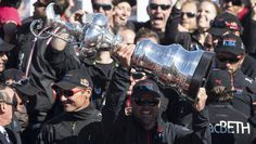 Brian MacInnes, originally from Nova Scotia, hoists the America's Cup on Wednesday after Oracle Team USA won the 34th edition of the sailing...