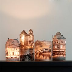 DIY Pretty illuminated houses; reminds me of the paper houses my dad and I used to make.