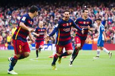 Lionel Messi of FC Barcelona celebrates with his teammates Luis Suarez and Sergio Busquets after scoring the opening goal during the La Liga match between FC Barcelona and RCD Espanyol at Camp Nou on May 8, 2016 in Barcelona