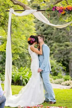 Wedding Dress: Hilde Heim - http://www.stylemepretty.com/portfolio/hilde-heim Photography: Calli B Photography - http://www.stylemepretty.com/portfolio/calli-b-photography   Read More on SMP: http://www.stylemepretty.com/australia-weddings/2015/05/14/colorful-bohemian-wedding-at-the-sunshine-coast-queensland/