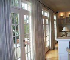 Delightful Large French Doors Paired With White Striped Curtains Window Treatments Set Beside Wall Cabinet Design Sliding Door Window Treatments