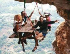 Rock Climbing Air Picnic @Erin Conner Kidman. Whoa lol. I would totally do it ^_^ ... as long as I could keep my harness on and connected to the anchor :P