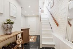 Stairs with white brick walls