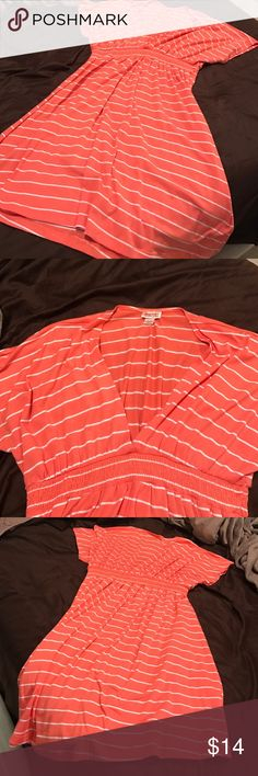 Mossimo Supply Co. coral swimsuit coverup Super comfortable coral short sleeve swimsuit coverup. Cotton material in very good condition. Worn twice. No stains or flaws. Tighter around chest and flows near stomach to the end of dress. White horizontal lines patterned throughout. A cinch fabric right underneath the V-neck part. Mossimo Supply Co. Swim Coverups