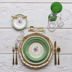 RENT: Florentine Chargers in White/Gold + Green Botanicals Vintage China + Chateau Flatware in Matte Gold + Chloe 24k Gold Rimmed Stemware + Chloe 24k Gold Rimmed Goblet in Emerald + Antique Crystal Salt Cellars  SHOP:Florentine Chargers in White/Gold + Chloe 24k Gold Rimmed Stemware