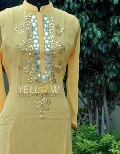 Summer parties?Wear this beautiful dull yellow georgette kurti with mirror and gota work at yoke.