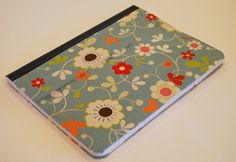 """I've had this tutorial for a LONG time...but have I done anything with it??  This is a """"composition"""" notebook but its covered in material. If any of you know me, you know that I LOVE paper....this cute material idea just makes it better."""