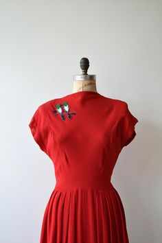 Vintage 1950s bright red rayon dress with cap sleeves, high neckline, princess seamed bodice, fitted waist, semi-full skirt, adorable pair of beaded birds at one shoulder and metal side zipper. --- M E A S U R E M E N T S --- fits like: medium bust: 34-37 waist: 28 hip: free length: 45