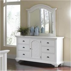 White dresser with large mirror on top.