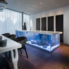 Aquarium kitchen 'Ocean' with Hydraulic worktop. Robert Kolenik's state of the art masterpiece is available in a limited edition and can be made to measure.