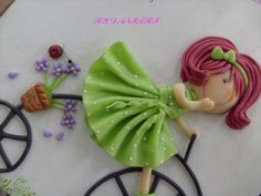 Girl on bike, cute! a porcelana fria polymer clay