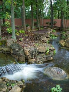 A stunning waterfall is just one of the highlights of an impressive custom oasis.