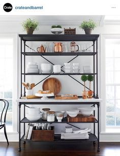 Shop French Kitchen Bakers Rack with Hutch. Hand finished for a soft antique look, the cast steel and aluminum rack doubles up on storage with four shelves and a frame shaped with slender legs, ornamental details and traditional cross bracing. French Kitchen, New Kitchen, Kitchen Decor, Kitchen Shop, Bakers Rack Kitchen, Funny Kitchen, Kitchen Interior, Kitchen Ideas, Kitchen Rack Design