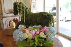 Moss wrapped around a plastic horse then hanging amaranthus was added for the mane and tail