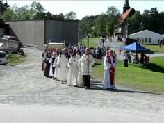 Catholic procession to St. Olav Chapel Stiklestad 2011. Clergy and members of The Norwegian Catholic Church walk in procession to St. Olav Chapel, after celebrating the Holy Mass in the old medieval church at Stiklestad, Norway. The relic of St. Olaf is carried by archbishop Emil Paul Tscherrig, Apostolic Nuncio to the Nordic countries. The procession took place July 31, 2011 as part of celebration of Olsok, the feast of St. Olaf, patron saint of Norway