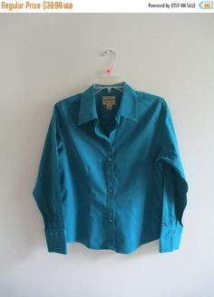 Check out this item in my Etsy shop https://www.etsy.com/listing/244478471/vintage-teal-green-non-iron-button-up