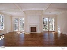 Fireplace flanked by double French doors
