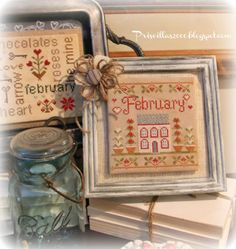 Frame that's got a magnet & sheet metal to change out the cross stitch piece monthly