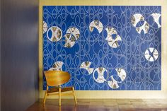 Luxury marquetry wall panel finished in blue veneer with grey geometric lines and mother of pearl