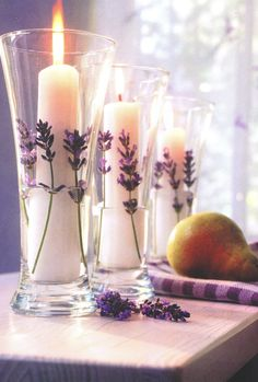 Vanilla candles in glass vases lined with fresh lavender, a lovely aroma...