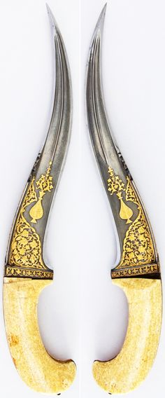 Indian (North) pesh kabz, 17th century, wootz steel blade, gold, ivory (walrus), H. 15 1/8 in. (38.4 cm); H. of blade 10 1/2 in. (26.7 cm); W. 3 in. (7.6 cm); Wt. 19.7 oz. (558.5 g), Met Museum, Bequest of George C. Stone, 1935. [ Swordnarmory.com ] #armaments #weapons #swords
