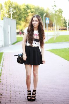 A white print crew-neck t-shirt and a black pleated skirt are your go-to outfit for lazy days. Black suede wedge sandals will add elegance to an otherwise simple look.  Shop this look for $82:  http://lookastic.com/women/looks/crew-neck-t-shirt-and-belt-and-skater-skirt-and-crossbody-bag-and-wedge-sandals/3294  — White Print Crew-neck T-shirt  — Beige Leather Belt  — Black Skater Skirt  — Black Leather Crossbody Bag  — Black Suede Wedge Sandals