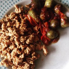 Spiced ground turkey with a side of brussel sprouts & tomatoes sautéed in balsamic --  Get your protein and veggies on!