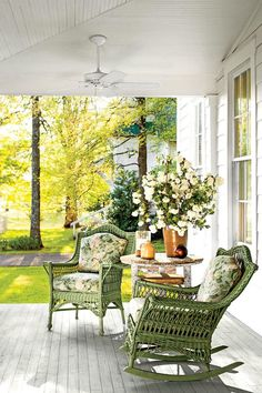 Porch Party for Two - Tiny Porches and Patios That Are Giving Us Major Inspiration - Southernliving. A consistent color scheme keeps this porch from being busy. Two wicker chairs and a simple vintage table make the space perfectly suited for a party of two.