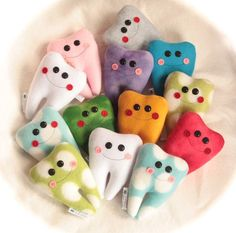 Tiny personalized tooth fairy pillows to hang on a door. (So the tooth fairy can be quieter at night and is less likely to forget to come.)