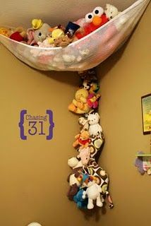 Another view of the stuffed animal storage. The top is a hammock from Babies R Us. The bottom is my creation. #Laundry Line Rope and #Clothespins.
