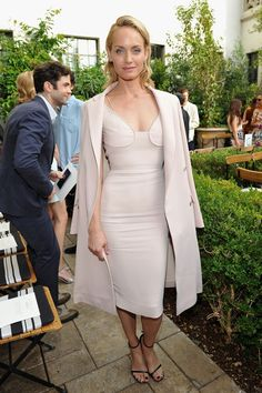 Amber Valletta in Victoria Beckham dress and Brock Collection coat at the CFDA/Vogue Fashion Fund Show.