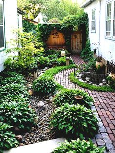 Simple Landscaping Ideas Around House Garden And Patio Narrow Side Yard Design With No Grass Trees Herb Plants Beside Brick Walkway Small Half Round Ponds Iron Fence