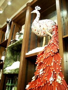 anthropologie store display - paper, chopstick wrappers and plastic spoons - only anthropologie can make art out of garbage!