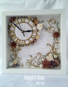 shadow box, clock movement, quilled flowers & vines?  hmmm... So pretty looks so white and new...with vintage style