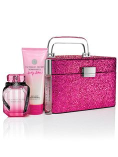 "Bombshell Glitter Train Case Victoria $85 7½""L x 7""W x 5""H Fragrance type: Fruity floral Notes: Purple passion fruit, Shangri-la peony and vanilla orchid Case: imported polyurethane/glitter"